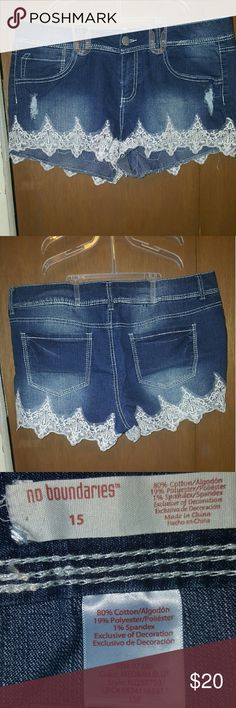 Shorts with Lace trim Very Cute dark blue denim shorts with off white lace edging loved these shorts but accidentally bought a size too small and didnt realize untill way to late. Worn only 1 time. No Boundaries Shorts Jean Shorts