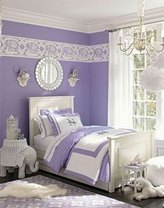 Girl's Dreamy bedroom: Paired with bright white, the color lavender looks even more elegant in this bedroom. The elephants add to exotic feel. A mirror over the headboard reflecting light creat an illusion of added spaciousness.