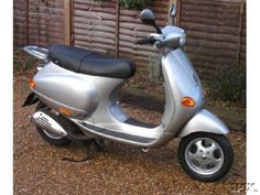 I'd love a Silver Vespa. or a Green One. Or Blue. Or Purple. or Black. Or Red.