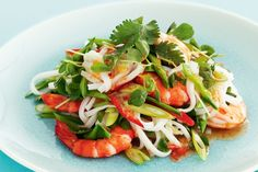 Gather fresh, colourful ingredients to create this lively prawn salad with lime and sweet chilli dressing.