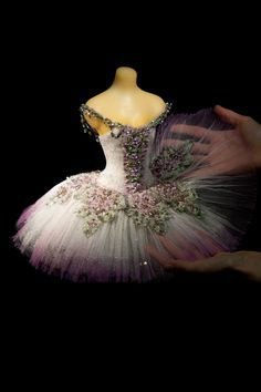 Our 'Lilac Fairy' miniature ballet costume. The bodice is covered with fine silver lace, and tiny swags of linked sequins festoon the shoulders. Silver leafed cabochons on the tutu panels are surrounded by tiny antique bullion springs. Ombre metallic lace and gelatine sequins, glint through, from beneath the top layer of lilac tinted tulle. Photography by George Chinn. To place an order please contact us at vinilla@thelittlecostumeshop.com