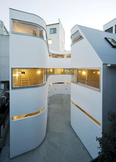 Townhouses in Japan...nice curve....shadow line makes it neat joint with the floor....