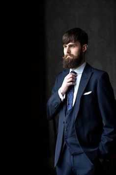 groom in our navy blue slim fit wedding suit with horseshoe waistcoat.