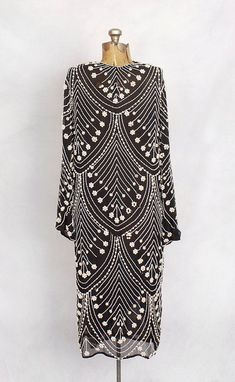 1920s black and white silk chiffon pearl-beaded gown. #artdeco
