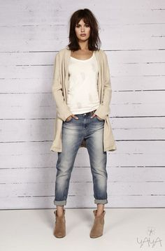 bleached boyfriend jeans, a long cream cardigan and tan ankle boots