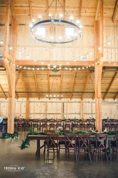 Christmas Winter wedding inside barn with tree & lights.  We love all the lovely winter touches they used for their special day.  From vintage lounge areas with plaid to antlers and greenery to lawn games.  Photos by Trisha Kay Photography by rentmydust.com