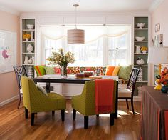 I love the idea of having a window seat bench in the dining room.