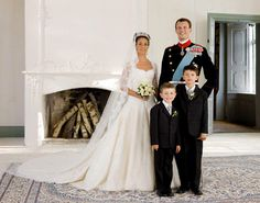 Prince Joachim of Denmark, Queen Margrethe's youngest son and his bride, French Marie Cavallier, pose with Prince Joachim's sons, Prince Felix (L) and Prince Nikolaj (R)
