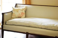 Reupholstered Antique Sofa; we have a sofa much like this in storage!