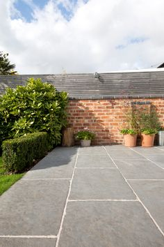 Worn Grey limestone has a rich and rustic charm, thanks to its antiqued and hand dressed edge finish.The grey palette of this stone makes it a fantastic stone for both internal and external applications, creating the popular infinity effect. Garden Slabs, Garden Tiles, Patio Slabs, Patio Tiles, Garden Paving, Driveway Tiles, Paving Stone Patio, Flagstone, Outdoor Paving