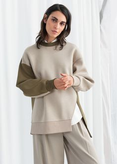 Oversized patchwork pullover sweater with a high crewneck, dropped shoulder seams, and a side slit opening. Voluminous sleeves Cocoon shapeLength of pullover: / (size Model wears: EU UK US 4 / Small Sport Fashion, Womens Fashion, Pinstriping Designs, Trouser Outfits, Wide Trousers, Pullover, Fashion Story, Shirt Outfit, Lounge Wear