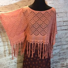 Black Poppy Shelley Crochet Poncho Delicate poncho top. Sheer crochet construction throughout. Large arm openings with draped fit. Bottom hemline features thin fringe details. Intricate cutouts throughout the body and sleeves. Love this rustic color and oh the possibilities.. I paired with this cute reversible skirt for a dressier boho style.. Gently used Black Poppy Sweaters Shrugs & Ponchos