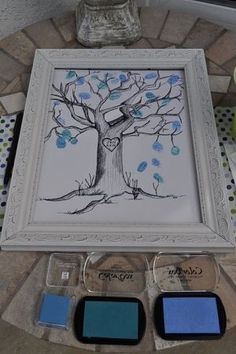 Everyone at baby shower puts a thumb print on the tree, for baby book. My friend did this... Such a great idea! by millicent