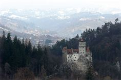 Bran Castle, famous as 'Dracula's Castle,' stands among Transylvanian mountains on March 2013 in Bran, Romania. Although is it only one among several locations linked to the Dracula legend, it retains the myth and tourists flock there in large numbers. National Geographic, Vampire Look, Dracula Castle, Medieval Castle, Halloween Night, Countries Of The World, Where To Go, Romania, Places To See