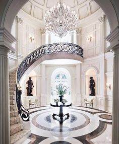 Grand entryway... The ceiling is too high, different colors, I'd prefer a double staircase, and something a bit more... open. But the detail is gorgeous.