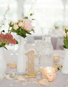 Add some sparkle to your wedding when these bold glitter table numbers at your reception!