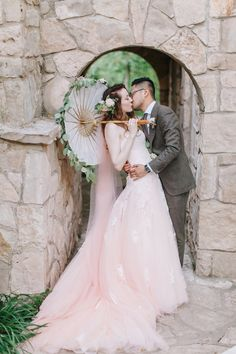 pink wedding dress - photo by Starling and Sage http://ruffledblog.com/romantic-texas-wedding-with-a-pink-wedding-dress #weddingdress #bride #bridal