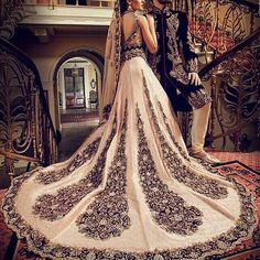Wow, talk about fancy indian wedding lehenga - the paisley teardrop designs on this white bridal lehenga make for a perfect indian wedding dress or use it for a fusion wedding dress. Not to mention it coordinates so well with the groom's wedding attire