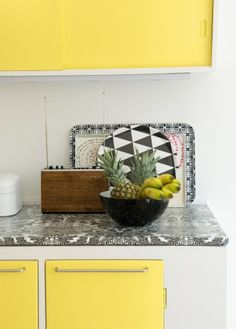 Graphic countertop freshens up this 1950's Danish kitchen. Great idea for run down rentals or before you have the money to remodel your kitchen.