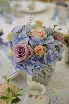 Purple & blue wedding flowers...I love where this is going.....softer tones of blue, purple, and even gold/yellow/peach?