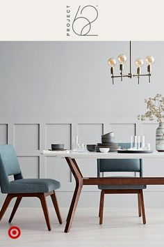 Meet a timeless, modern dining scene that will stun you and your wallet. Start with a hardwood table paired with armless upholstered chairs. Add an assortment of glass and ceramic tableware, the glow of an industrial-inspired chandelier, and finish with a marbled vase and flowers. Project 62, only at Target.
