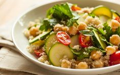 Creamy tahini and tart wine vinegar dress whole wheat couscous, tossed with tomatoes, zucchini and chickpeas. Follow the time-saving techniques in the method to make extra-quick work of this salad or light main course.
