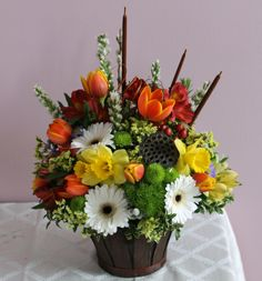 Masculine floral arrangement created for a male funeral, created at Harbourview Flowers in Thunder Bay, ON.