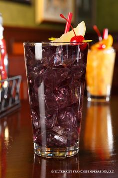 Purple Haze - Three Olives Grape Vodka, Peach Schnapps, Blue Curacao, Sweet and Sour, Sprite and Cranberry Juice