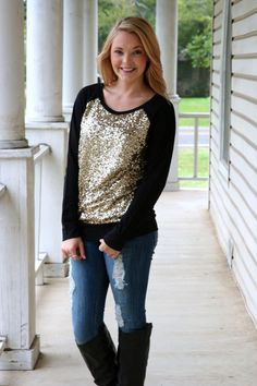 Hazel & Olive Boutique! Love them and this super cute sweater, that totally comes in handy on Gameday, seeing as I am a HUGE NO Saints fan!!(: