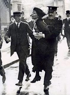 THANK YOU, EMMELINE!!! Suffragette (women's rights movement) Emmeline Pankhurst being arrested after protesting near Buckingham Palace. London, England, [1907-1914].