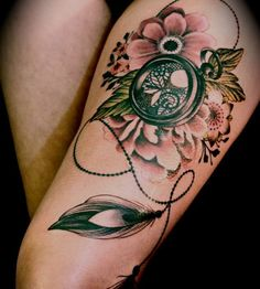 Emerald lace flower tattoo with locket