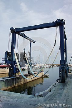 Photo about A sling crane sits empty in the small Mediterranean fishing harbor of Ampolla Spain. Image of ampolla, empty, lift - 81075071 Jon Boat, Marina Bay Sands, Crane, Empty, Boats, Spain, Fishing, Ships, Stock Photos