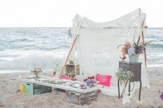 Elizabeth of Bella Lilly Studio was inspired by the style of bride-turned-friend Kat to design this beach picnic styled inspiration shoot for a fun, free-spirited night with the girls.
