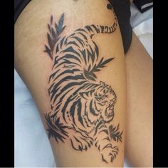 Japanese Tribal tiger tattoo. Done by Orio Guevara at Rose Gold tattoo in San Francisco.  It represents strength, ferocity, courage, and regal beauty #thightattoo #girlswithtattoos