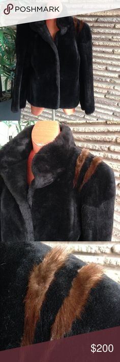 """Vintage Faux Fur Jacket with Real Mink This is one of the most beautiful faux fur jackets that I have seen. The attention to detail is exquisite! The body is a faux fur but there is real mink on the shoulders. Fully lined Made by CARMEN in Sweden - known for their fur coats and jacket. Listed Size: None  Approximate measurements taken laid flat: Shoulder to shoulder: 18 Armpit to armpit: 20"""" Sleeve Length: 25.5 Length: 24.25 """" Very good to excellent pre-owned  condition and coming from a non…"""