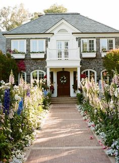 Stone house and flower window boxes