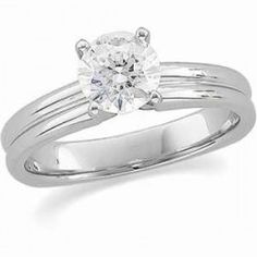 Choose this popular square shank four prong solitaire engagement ring in 14K white gold for its attractive and functional design. This solitaire engagement ring is also available in many popular metals.