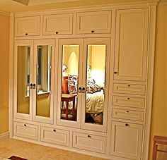 Adore this: Handmade Custom built-in his & hers closets. Great for out full wall closet.