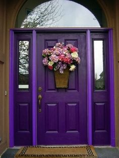 The front door really is the key focal point to the exterior of any house, so why not make a bold move and paint it an eye-catching color? Brightly painted doors like the purple one above are everywhere in France, and I absolutely adore the way they look, don't you?