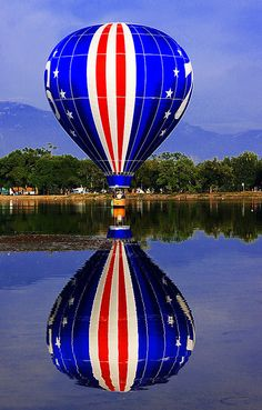 76 Stars and Stripes, Red, White, & Blue Hot Air Balloon Dipping in Prospect Lake, Memorial Park, Colorado Balloon Classic