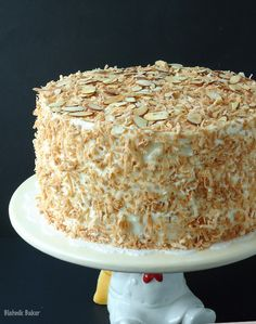 Coconut Almond Cream Cake is a coconut lover& dream cake and the perfect Easter dessert recipe. Coconut cake, almond cream filling, and coconut frosting! Just Desserts, Delicious Desserts, Dessert Recipes, Cheesecake Recipes, Baking Recipes, Mini Cakes, Cupcake Cakes, Cupcakes, Cake Cookies