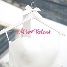 a white hanger with peach red lettering, perfect for garden wedding. Personalized Wedding Dress Hanger, Bride Bridesmaid Wood Name Hanger, Custom Wedding Bridal Hanger,Bridal Shower Gift