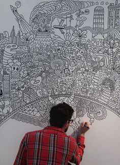 Serge Seidlitz drawing during Birmingham Childrens' Hospital 'Doodle Weekend' (2010) - photo from Serge Seidlitz;  The art was made for a hospital fund-raiser.  The artist drew the outlines and invited members of the public color in the white spaces, and the final boards will be used to decorate the walls at the hospital.