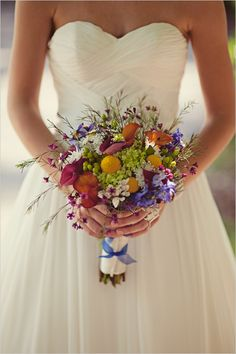 wild flower bouquet for centerpieces with orange and purple and catalilies.