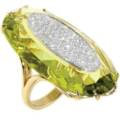 """This is an interesting way of using stones and stone setting.  Lemon quartz """"Roma Aphrodite"""" ring with diamonds by Casato"""
