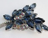 I'm So Blue: An Etsy Treasury by vintagejerseygirl30 that features our DeLizza & Elster Juliana brooch! Double click through to see all the incredible blue rhinestone beauties!