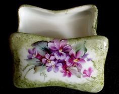 "Lovely porcelain ring/trinket/jewelry box measures 2-1/2"" long and features a floral design with violets and forget-me-nots. This piece is painted entirely by hand. No decals were applied for this decoration and it is signed by myself. $23.00 + $5.95 shipping"