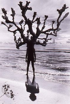 Jerry Uelsmann, Untitled (Man With Branches On Beach), 1975