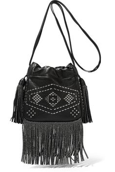 Saint Laurent's textured-leather 'Helena' bag is a combination of boho and biker cool. Designed in a bucket silhouette, it has silver studs, swishy fringing and a durable twill-lined interior. Carry yours cross-body. #SaintLaurent