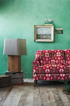 Love this couch and the green wall!